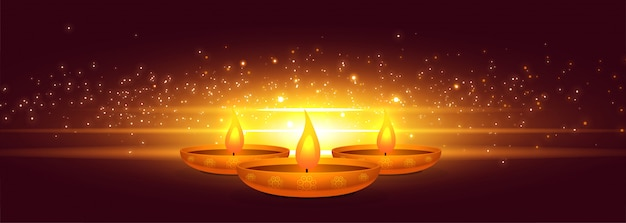 Glowing diwali diya with light sparkle banner