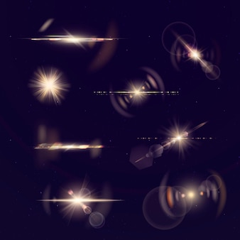 Glowing gold lens flare  set Free Vector