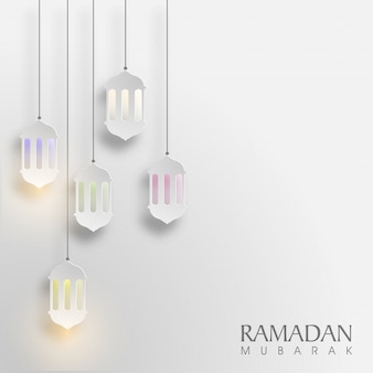 Glowing hanging paper lamps decorated background for islamic holy month, ramadan mubarak.
