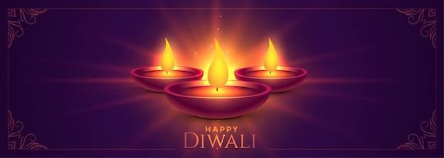 Glowing happy diwali diya lamps banner