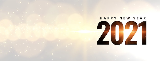 Incandescente felice anno nuovo 2021 su effetto luce bokeh