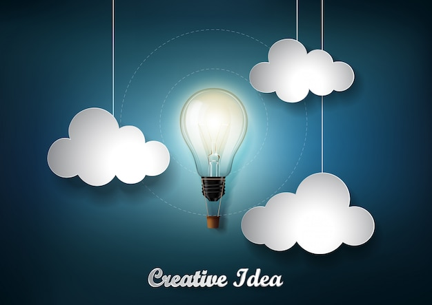 Glowing light bulb is among a lot of cloud on dark blue background with origami paper cut style, representation of creative business idea concept