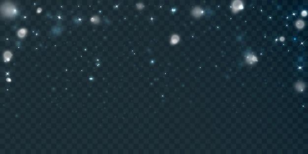 透明な背景に分離された多くのキラキラ粒子による輝く光の効果