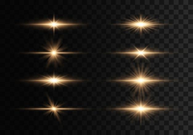 輝く光と星。透明な背景に分離されました。光のセットが爆発します。きらめく魔法のダスト粒子。