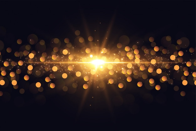 Glowing lights flare sparkles golden bokeh background