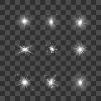 白熱灯、星、輝きのセット。暗い透明な背景の星のコレクション。図