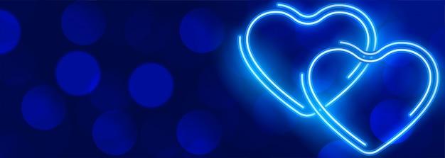 Glowing neon blue hearts bokeh banner