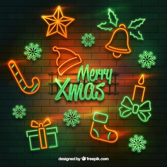 Glowing neon christmas elements on a brick wall background