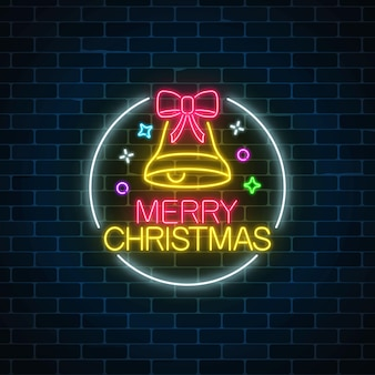 Glowing neon christmas sign with christmas bell and bow-knot in circle frame.