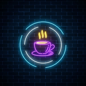 Glowing neon coffee cup sign in circle frames on a dark brick wall background. night street signboard of cafe.