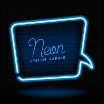 Glowing neon empty speech bubble frame. rectangle blank speech bubble in neon style on dark brick wall background.
