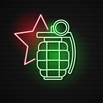 レンガ壁の背景に分離された輝くネオン手手榴弾アイコン。爆弾爆発。