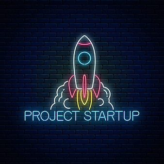 Glowing neon sign of business project startup on dark brick wall background. business fast start symbol as a flying rocket in neon style. vector illustration.