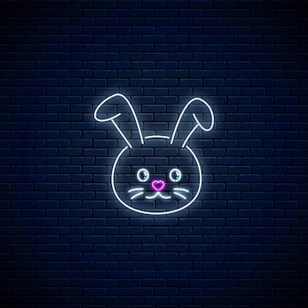Glowing neon sign of cute rabbit in kawaii style on dark brick wall background. cartoo happy smiling bunny in neon style. vector illustration.