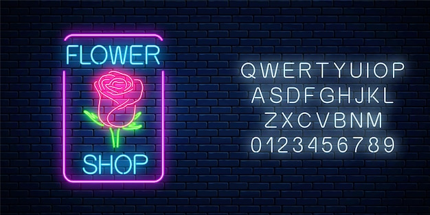 Glowing neon sign of flower shop in rectangle frame with alphabet on dark brick wall