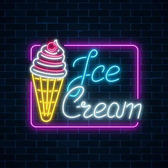 Glowing neon sign of ice cream with cherry on dark brick wall background. fruit ice-cream in waffle cone.