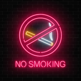 Glowing neon sign no smoking on dark brick wall of nightclub or bar.