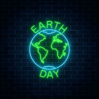 Glowing neon sign of world earth day with globe symbol and greeting text on dark brick wall