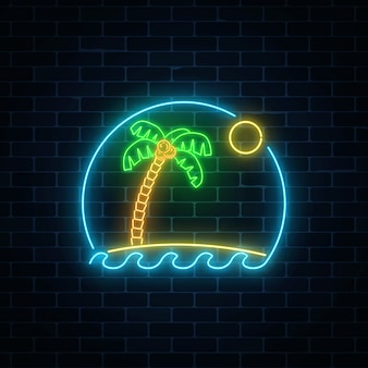 Glowing neon summer sign with palm, sun, island and ocean in round frame on dark brick wall background.