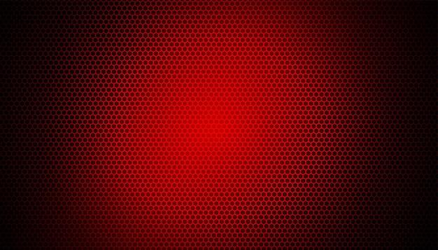 Luce rossa incandescente su sfondo in fibra di carbonio