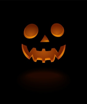 Glowing scary face pumpkin isolated on black