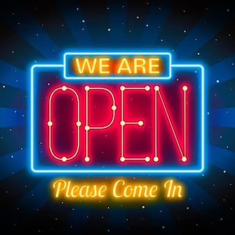 輝く「私たちは開いている」サイン