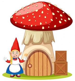 白い背景の上のキノコの家の漫画のキャラクターの横に立っているノーム