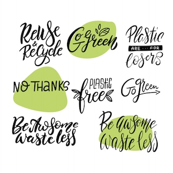 Go green, waste less big lettering set. modern calligraphy quotes and phrases with green leaves.
