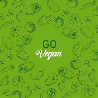 Go vegan lettering with vegetables pattern in green background