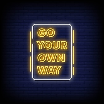 Go your own way neon signboard on brick wall