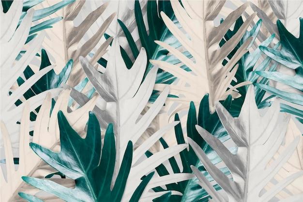 金と緑のヤシの葉の背景