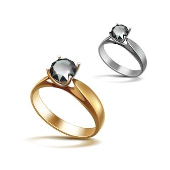 ゴールドとシルバーの婚約指輪と黒の光沢のあるクリアダイヤモンドクローズアップ白で隔離