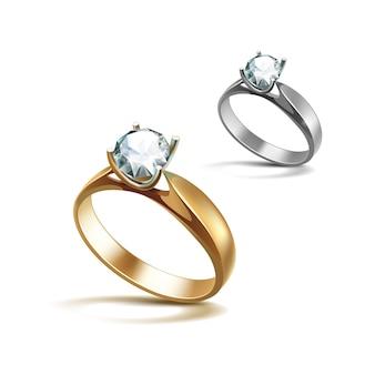 ゴールドとシルバーの婚約指輪と白の光沢のあるクリアダイヤモンドクローズアップ白で隔離