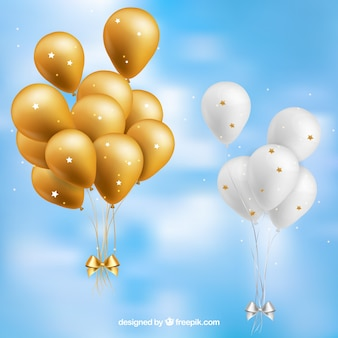 Gold and white balloons bunch collection in the sky