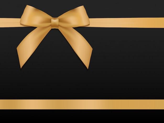 リボンとゴールドの弓。黒の背景に光沢のある休日ゴールドサテンリボン