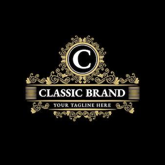 Gold calligraphic feminine floral hand drawn heraldic monogram antique vintage style luxury logo design