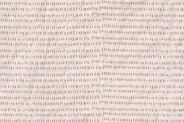 しわくちゃの紙のテクスチャ背景に金の破線パターン