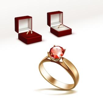 Золотое обручальное кольцо с красным блестящим прозрачным бриллиантом в красной шкатулке крупным планом на белом фоне