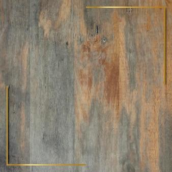 Gold frame on grunge wooden background