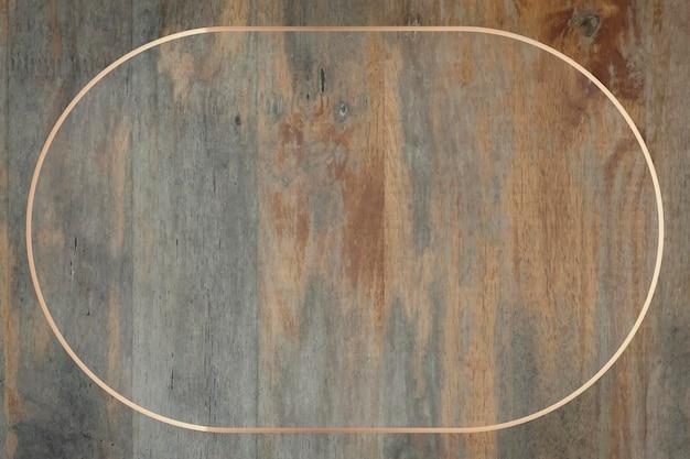 グランジ木製の背景にゴールドフレーム