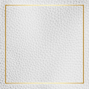 Gold frame on white leather background