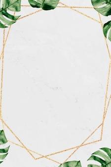 大理石の織り目加工の背景に葉を持つゴールドフレーム