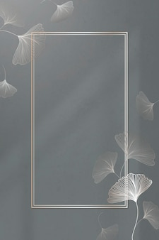 Gold frame with ginkgo leaf pattern vector
