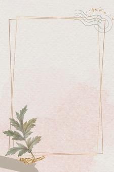 Gold frame with leaf on beige background