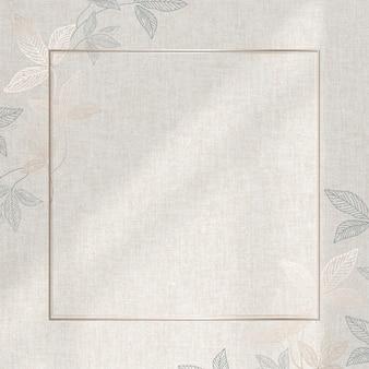 ベージュの背景に葉のパターンとゴールドフレーム