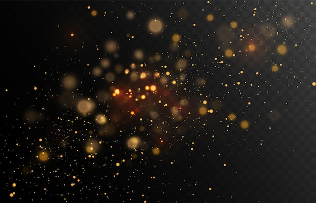 Gold glitter dust on a dark background with lens flares and light effects