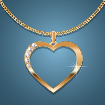 Gold heart necklace on a gold chain.