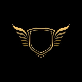 Gold heraldic vintage shield with wings logo template on black background