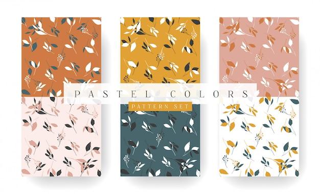 金の葉のパステルカラーのシームレスパターンコレクション