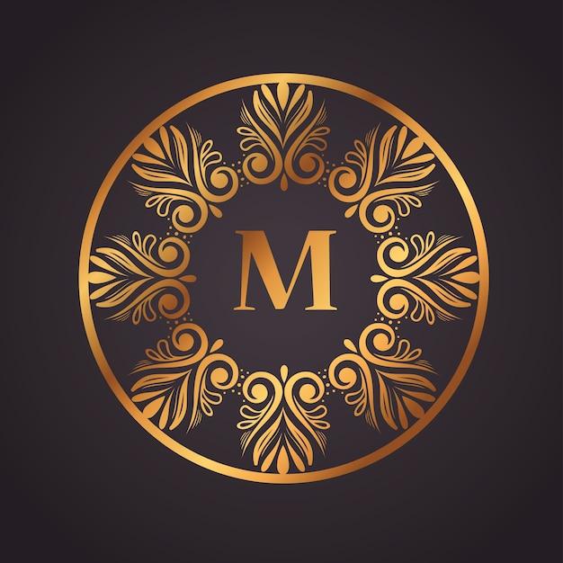 Золотая роскошная буква m в круговой рамке